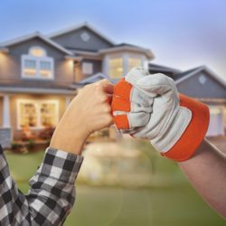 Homeowner and worker fist pounding